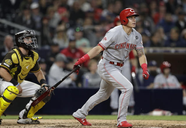 Cincinnati Reds' Derek Dietrich watches his two-run home run during the 11th inning of the team's baseball game against the San Diego Padres, Friday, April 19, 2019, in San Diego. (AP Photo/Gregory Bull)