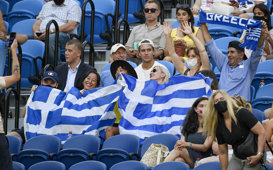 Greek fans cheer on Greece's Stefanos Tsitsipas during his semifinal against Russia's Daniil Medvedev at the Australian Open tennis championship in Melbourne, Australia, Friday, Feb. 19, 2021.(AP Photo/Andy Brownbill)