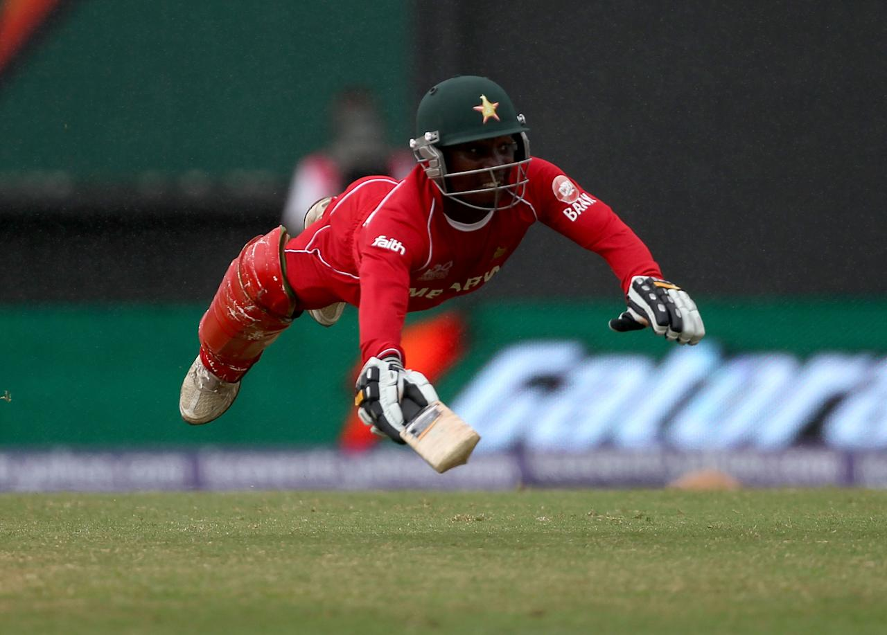 PROVIDENCE, GUYANA - MAY 03:  Tatenda Taibu of Zimbabwe dives to make his ground during the ICC T20 World Cup Group B match between Sri Lanka and Zimbabwe at the Guyana National Stadium Cricket Ground on May 3, 2010 in Providence, Guyana.  (Photo by Clive Rose/Getty Images)