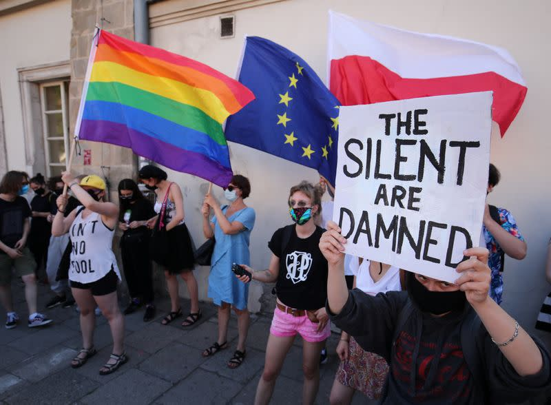 People take part in a rally in support of the LGBT community in Krakow
