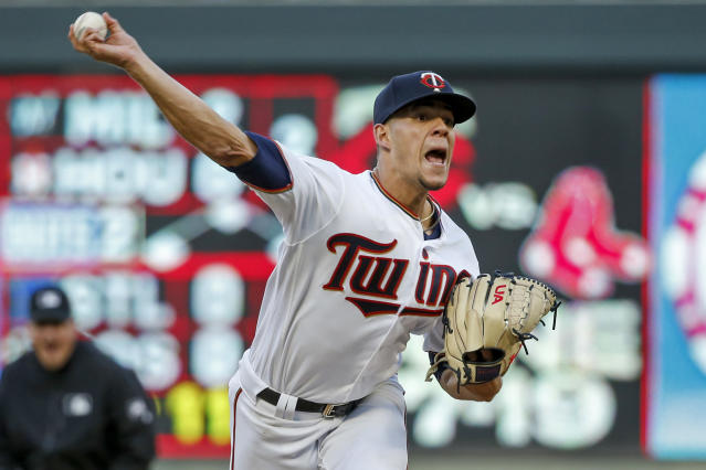 Minnesota Twins pitcher Jose Berrios throws to a Seattle Mariners batter during the second inning of a baseball game Wednesday, June 12, 2019, in Minneapolis. (AP Photo/Bruce Kluckhohn)