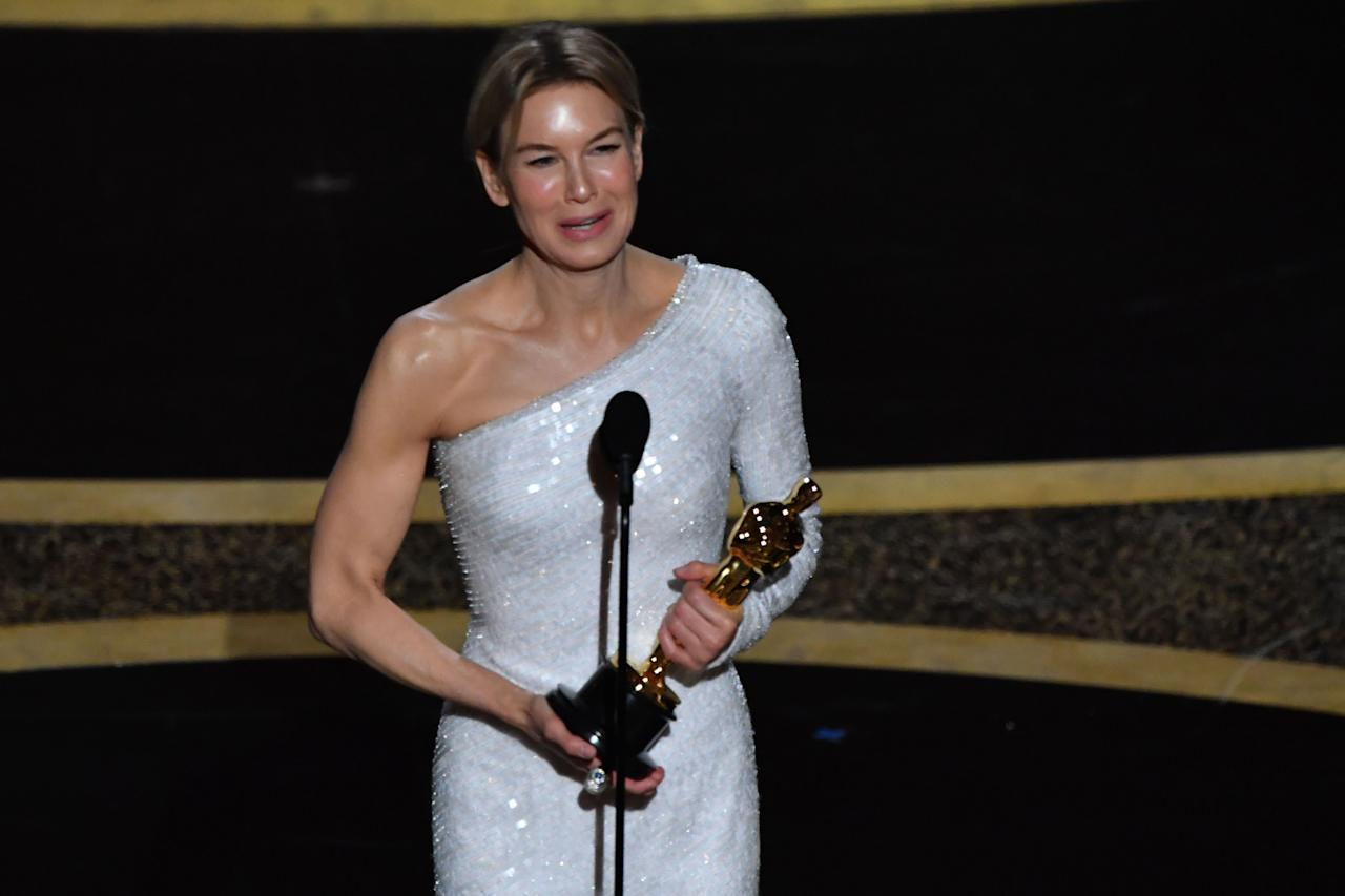 "Renee Zellweger accepts the award for Best Actress in a Leading Role for ""Judy"" during the 92nd Oscars at the Dolby Theatre in Hollywood, California on February 9, 2020. (Photo by MARK RALSTON/AFP via Getty Images)"