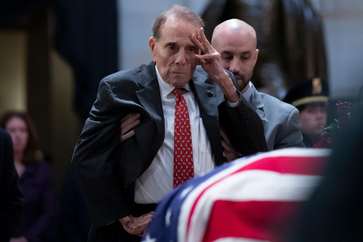 Former Senator Bob Dole salutes before the flag-draped coffin of former President George H.W. Bush at the U.S. Capitol rotunda December 4, 2018 in Washington, D.C. (Photo: Alex Edelman/AFP/Getty Images)