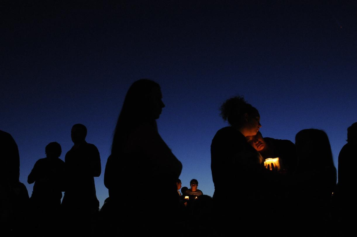 A candlelight vigil was held at Walt Morey Middle School in Troutdale Oregon Tuesday night June 10, 2014 for Emilio Hoffman, the victim of a shooting at Reynolds High School Tuesday June 10, 2014. The suspect is believed to have shot himself. A teacher sustained non-life-threatening injury. (AP Photo/The Oregonian, Stephanie Yao Long)
