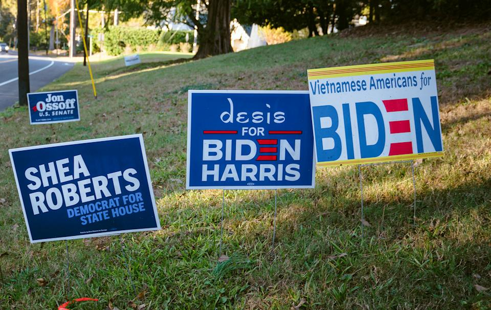 """Political signs outside the home of Cam Ashling, chair of Georgia Advancing Progress PAC, in Atlanta on Nov. 13<span class=""""copyright"""">Nicole Craine—The New York Times/Redux</span>"""