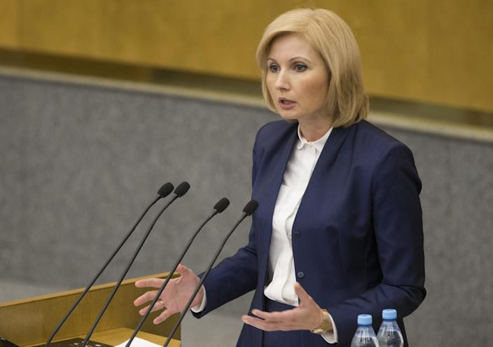 Russian lawmaker Olga Batalina addresses the State Duma (lower parliament house) in Moscow, Russia, Wednesday, Jan. 25, 2017. The State Duma voted overwhelmingly Wednesday to eliminate criminal liability for battery on family members that does not cause bodily harm. The bill that makes battery on a family member punishable by a fine or a 15-day day arrest has yet to be approved in the third reading. (AP Photo/Alexander Zemlianichenko)