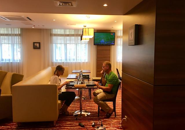 Reuters television producer Elena Gyldenkerne and cameraman Gennady Novik edit a story in the lobby of a hotel in Samara, Russia, June 19, 2018. As well as shooting all the matches, Reuters photographers are producing pictures showing their own quirky view from the sidelines of the World Cup. REUTERS/David Gray