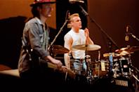 LONDON, UNITED KINGDOM - JUNE 12: The Edge and Larry Mullen Jnr of U2 perform on stage at Wembley Stadium on June 12th, 1987 on 'The Joshua Tree' tour in London, England. (Photo by Pete Still/Redferns)