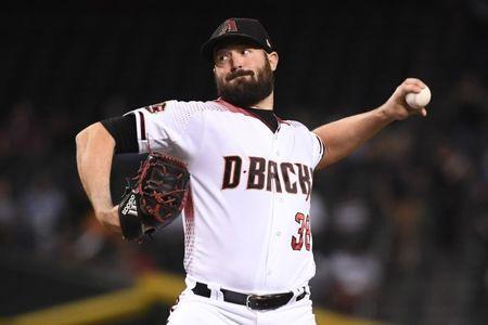 FILE PHOTO: Sep 24, 2018; Phoenix, AZ, USA; Arizona Diamondbacks starting pitcher Robbie Ray (38) delivers a pitch in the first inning against the Los Angeles Dodgers at Chase Field. Mandatory Credit: Jennifer Stewart-USA TODAY Sports - 11313264
