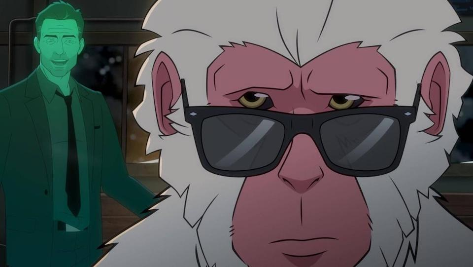 A snow monkey wears sunglasses as a green ghost in a suit stands behind him on Marvel's Hit-Monkey