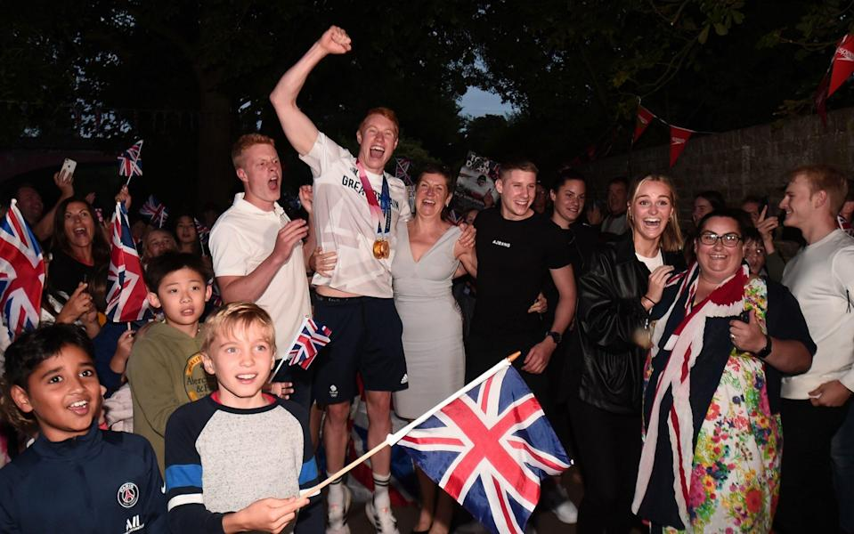 Tom Dean, double Olympic Gold medal Winning Swimmer of team GB arrives at his homecoming party on August 02, 2021 in Maidenhead, England - GETTY IMAGES