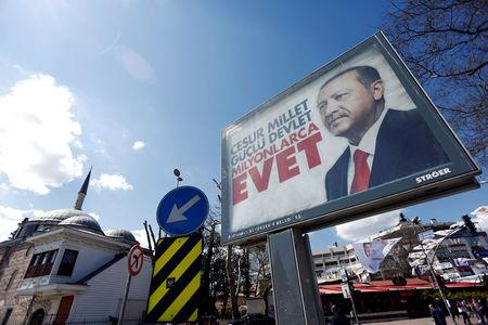 "A billboard displaying a picture of Turkish President Tayyip Erdogan and a slogan reading: ""Brave nation. Strong state. Millions of YES"" is pictured ahead of the constitutional referendum in Istanbul, Turkey April 10, 2017. REUTERS/Murad Sezer"