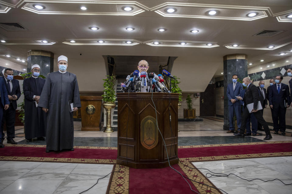 French Foreign Minister Jean-Yves Le Drian speaks during a press conference after a meeting with Muslim Grand Imam, Sheikh Ahmed el-Tayeb, at the headquarters of Al Azhar, in Cairo, Egypt, Sunday, Nov. 8, 2020. Le Drian visited Cairo on Sunday to meet with political and religious leaders in an effort to calm tensions and misunderstandings with the Arab and Muslim world following anti-French protests and three Islamic extremist attacks on France. (AP Photo/Nariman El-Mofty)