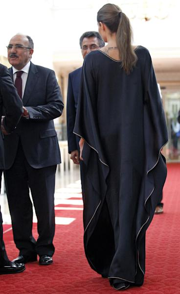 Hollywood star Angelina Jolie, in her role as special envoy for the U. N. refugee agency, arrives for a meeting with Turkish deputy Prime Minister Besir Atalay, left, in Ankara, Turkey, Friday, Sept. 14, 2012. Jolie met with Syrian refugees in Turkey Thursday, where there are more than 80,000 Syrian refugees in 11 camps. (AP Photo/Umit Bektas, Pool)