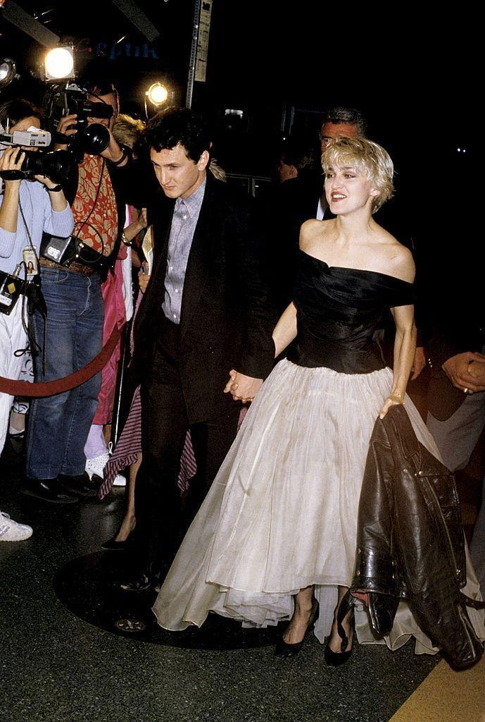 "<p>Madonna and actor Sean Penn <a href=""http://people.com/archive/cover-story-everyone-said-it-wouldnt-last-vol-28-no-24/"" rel=""nofollow noopener"" target=""_blank"" data-ylk=""slk:wed"" class=""link rapid-noclick-resp"">wed</a> in August 1985, on Madonna's birthday. The pair has a tumultuous marriage often followed by the press, due to Penn's violent outbursts. Madonna eventually filed for divorce in 1989. </p>"