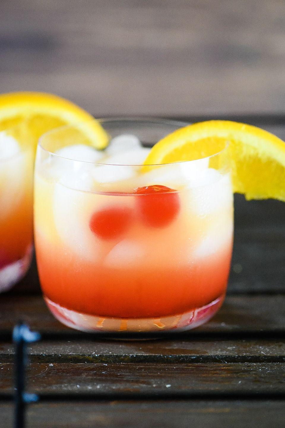 """<p>This two-toned drink will have you feeling like you're on a tropical island—even if you're just in the backyard. It's perfect for any summer party. </p><p><strong>Get the recipe at <a href=""""https://dudethatcookz.com/tequila-sunrise-cocktail/"""" rel=""""nofollow noopener"""" target=""""_blank"""" data-ylk=""""slk:Dude That Cookz"""" class=""""link rapid-noclick-resp"""">Dude That Cookz</a>.</strong></p><p><a class=""""link rapid-noclick-resp"""" href=""""https://go.redirectingat.com?id=74968X1596630&url=https%3A%2F%2Fwww.walmart.com%2Fsearch%2F%3Fquery%3Dutensils&sref=https%3A%2F%2Fwww.thepioneerwoman.com%2Ffood-cooking%2Fmeals-menus%2Fg36432840%2Ffourth-of-july-drinks%2F"""" rel=""""nofollow noopener"""" target=""""_blank"""" data-ylk=""""slk:SHOP UTENSILS"""">SHOP UTENSILS</a></p>"""