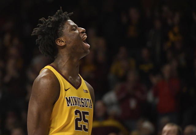 Minnesota center Daniel Oturu celebrates a dunk against the Michigan in the second half during an NCAA college basketball game on Sunday, Jan. 12, 2020, in Minneapolis. (AP Photo/Hannah Foslien)