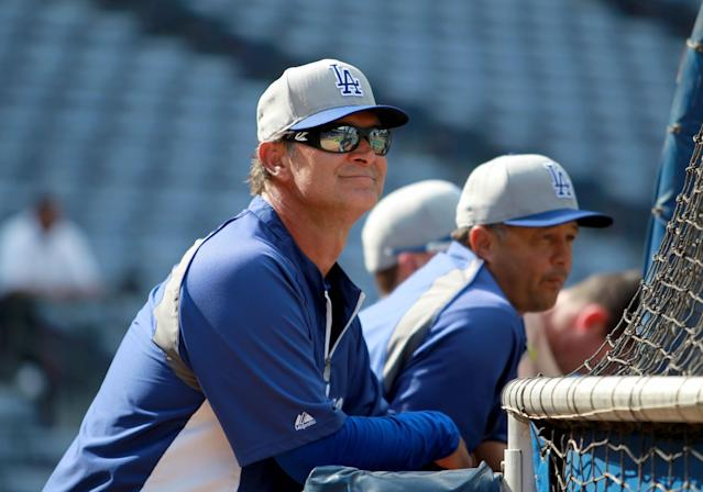 Los Angeles Dodgers manager Don Mattingly watches batting practice Wednesday, Oct. 2, 2013, in Atlanta. The Dodgers are scheduled to face the Atlanta Braves in Game 1 of baseball's NL division series Thursday. (AP Photo/Atlanta Journal Constitution, Jason Getz)