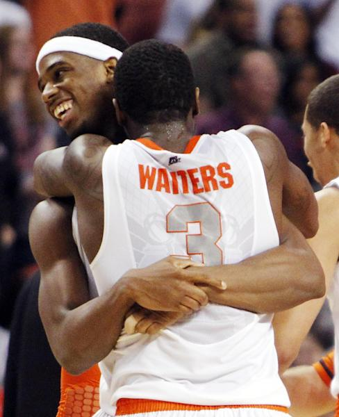 Syracuse guard Dion Waiters (3) and forward C.J. Fair, rear, celebrate their 64-63 win over Wisconsin in the second half of an East Regional semifinal game in the NCAA men's college basketball tournament, Thursday, March 22, 2012, in Boston. (AP Photo/Michael Dwyer)