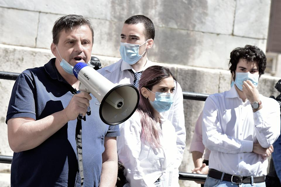 ROME, ITALY - MAY 27 : Carlo Calenda with megaphone intervenes at the Young Doctors' demonstration, on May 27, 2020 in Rome, Italy.Students, medical interns and young doctors protest in front of the Chamber of Deputies in Montecitorio to denounce the lack of attention of the government relaunch decree to the demands of young white coats. Many Italian businesses have been allowed to reopen, after more than two months of a nationwide lockdown meant to curb the spread of Covid-19. (Photo by Simona Granati - Corbis/Corbis via Getty Images). (Photo: Simona Granati - Corbis via Getty Images)