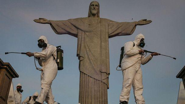 PHOTO: Military personnel belonging to the Joint Command East disinfect the Sanctuary where the statue of Christ the Redeemer is located on Aug. 13, 2020, in Rio de Janeiro. (Andre Coelho/Getty Images)