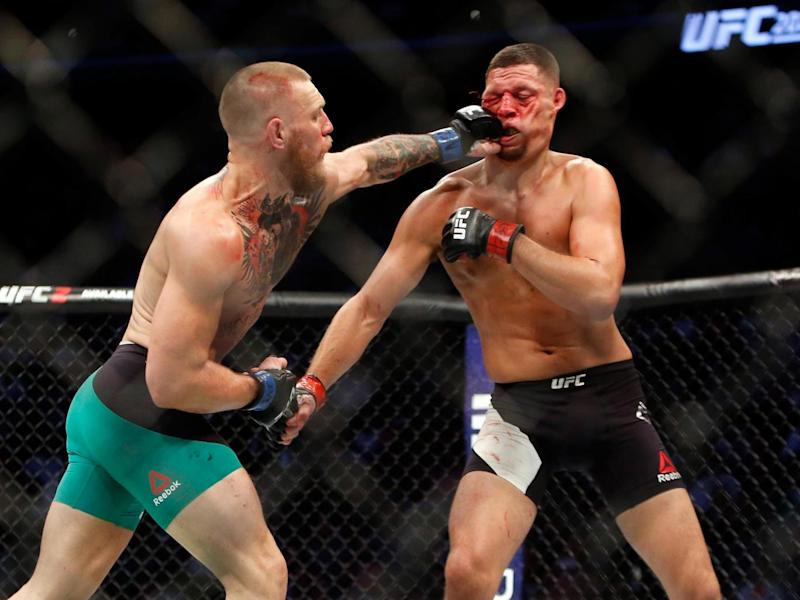 His famous left-hand counter in action, against Nate Diaz at UFC 202 (Getty)