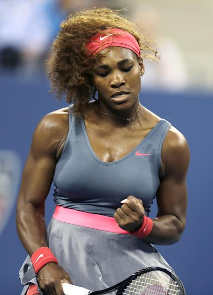 Serena Williams, of the United States, pumps her fist after winning a point against Carla Suarez Navarro, of Spain, during a quarterfinal of the U.S. Open tennis tournament, Tuesday, Sept. 3, 2013, in New York. (AP Photo/Charles Krupa)