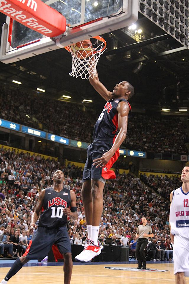 MANCHESTER, UK - JULY 19: Kevin Durant #5 of the 2012 US Men's Senior National Team dunks during an exhibition game against Great Britain's Men's team at the Manchester Arena on July 19, 2012 in Manchester, UK. NOTE TO USER: User expressly acknowledges and agrees that, by downloading and or using this photograph, User is consenting to the terms and conditions of the Getty Images License Agreement. Mandatory Copyright Notice: Copyright 2012 NBAE (Photo by Nathaniel S. Butler/NBAE via Getty Images)