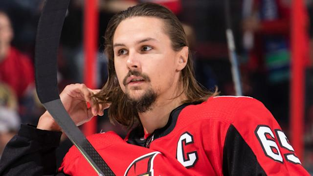 A summer filled with Erik Karlsson trade rumors reached its conclusion as NHL training camps opened Thursday.