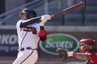 Atlanta Braves Travis d'Arnaud (16) hits a single in 12th inning against the Cincinnati Reds during Game 1 of a National League wild-card baseball series, Wednesday, Sept. 30, 2020, in Atlanta. (AP Photo/John Bazemore)