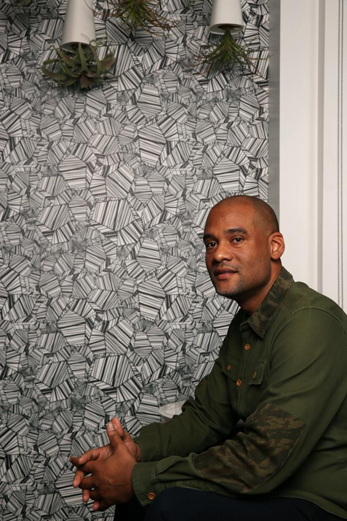 """4thMVMT CEO Karim Webb poses for a portrait at his offices on November 22, 2019, in Los Angeles. Webb says he wants to help Black entrepreneurs build generational wealth. <span class=""""copyright"""">(Dania Maxwell / Los Angeles Times)</span>"""
