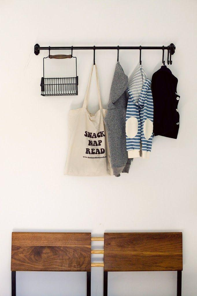 """<p>Forget the giant coat rack that always topples over. This horizontal option takes up zero floor space, but offers the same amount of storage. Oh, and did we mention the basket is the perfect spot to drop your keys, so you're never hunting around the house for them?</p><p>See more at <a href=""""http://cupofjo.com/2013/04/los-angeles-home-tour/"""" rel=""""nofollow noopener"""" target=""""_blank"""" data-ylk=""""slk:Cup of Jo"""" class=""""link rapid-noclick-resp"""">Cup of Jo</a>.</p><p><a class=""""link rapid-noclick-resp"""" href=""""https://go.redirectingat.com?id=74968X1596630&url=https%3A%2F%2Fwww.ikea.com%2Fus%2Fen%2Fp%2Fhultarp-rail-black-00448769%2F&sref=https%3A%2F%2Fwww.countryliving.com%2Fhome-maintenance%2Fg37186772%2Fentryway-ikea-hacks%2F"""" rel=""""nofollow noopener"""" target=""""_blank"""" data-ylk=""""slk:BUY NOW"""">BUY NOW</a> <strong><em>Rail, $95</em></strong></p>"""