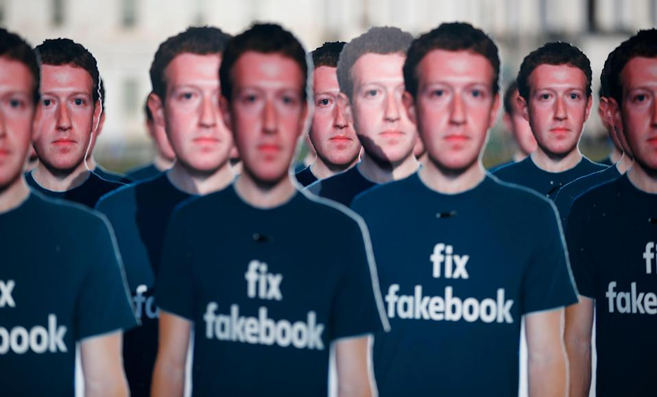 Life-sized cutouts of Facebook CEO Mark Zuckerberg wearing 'Fix Fakebook' t-shirts are displayed by advocacy group, Avaaz, on the South East Lawn of the Capitol on Capitol Hill in Washington, Tuesday, April 10, 2018, ahead of Zuckerberg's appearance before a Senate Judiciary and Commerce Committees joint hearing. (AP Photo/Carolyn Kaster)