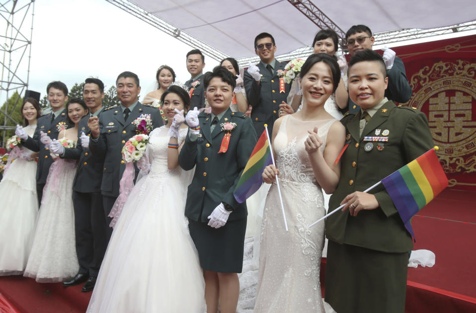 <p>Two lesbian couples, from right to left, Yi Wang and Yumi Meng, Chen Ying-hsuan and Li Li-chen pose for a photo during a military mass weddings ceremony in Taoyuan city, northern Taiwan, Friday, Oct. 30, 2020. The two lesbian couples tied the knot in a mass ceremony held by Taiwan's military on Friday in a historic step for the island. Taiwan is the only place in Asia to have legalized gay marriage, passing legislation in this regard in May 2019.(AP Photo/Chiang Ying-ying)</p>