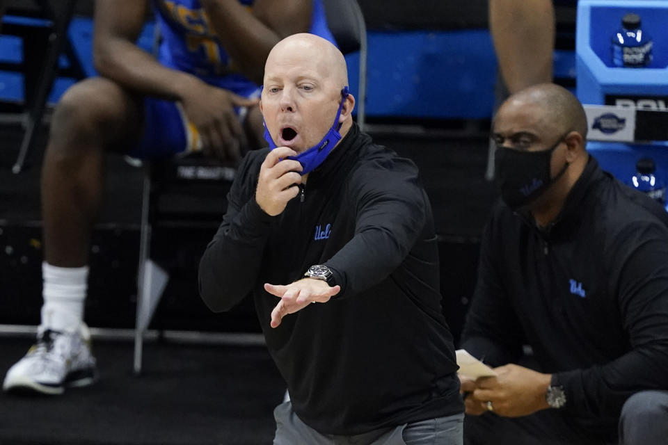 UCLA head coach Mick Cronin directs his team during the first half of an Elite 8 game against Michigan in the NCAA men's college basketball tournament at Lucas Oil Stadium, Tuesday, March 30, 2021, in Indianapolis. (AP Photo/Darron Cummings)