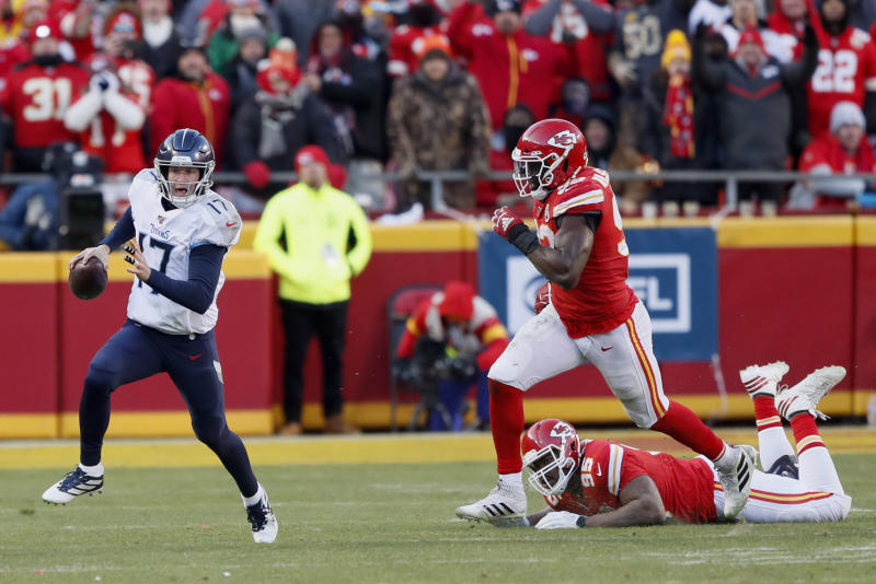 Tennessee Titans' Ryan Tannehill (17) scrambles during the second half of the NFL AFC Championship football game against the Kansas City Chiefs Sunday, Jan. 19, 2020, in Kansas City, MO. (AP Photo/Charlie Neibergall)