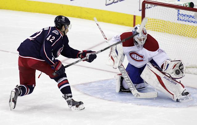 Montreal Canadiens' Peter Dudaj, right, of Slovakia, makes a save against Columbus Blue Jackets' Artem Anisimov, of Russia, during the shoot out of an NHL hockey game Friday, Nov. 15, 2013, in Columbus, Ohio. The Canadiens beat the Blue Jackets 3-2. (AP Photo/Jay LaPrete)
