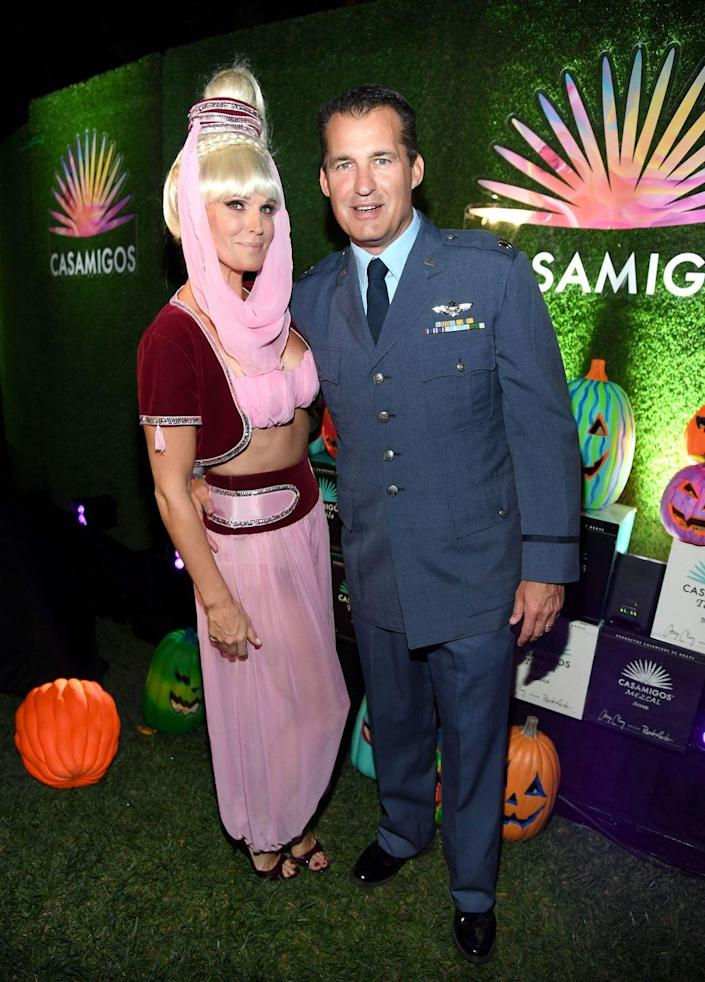 """<p>Dress up as a genie and an Air Force captain to become Jeannie and Capt. Tony Nelson from <em>I Dream of Jeannie</em>. </p><p><a class=""""link rapid-noclick-resp"""" href=""""https://www.amazon.com/Hoerev-Super-Modal-Spandex-Pilates/dp/B019VSWHZC?tag=syn-yahoo-20&ascsubtag=%5Bartid%7C10070.g.1923%5Bsrc%7Cyahoo-us"""" rel=""""nofollow noopener"""" target=""""_blank"""" data-ylk=""""slk:SHOP PINK PANTS"""">SHOP PINK PANTS</a></p><p><a class=""""link rapid-noclick-resp"""" href=""""https://www.amazon.com/Generic-Force-Senior-Pilot-Insignia/dp/B00GMO4Z4K?tag=syn-yahoo-20&ascsubtag=%5Bartid%7C10070.g.1923%5Bsrc%7Cyahoo-us"""" rel=""""nofollow noopener"""" target=""""_blank"""" data-ylk=""""slk:SHOP CAPTAIN PIN"""">SHOP CAPTAIN PIN</a></p>"""