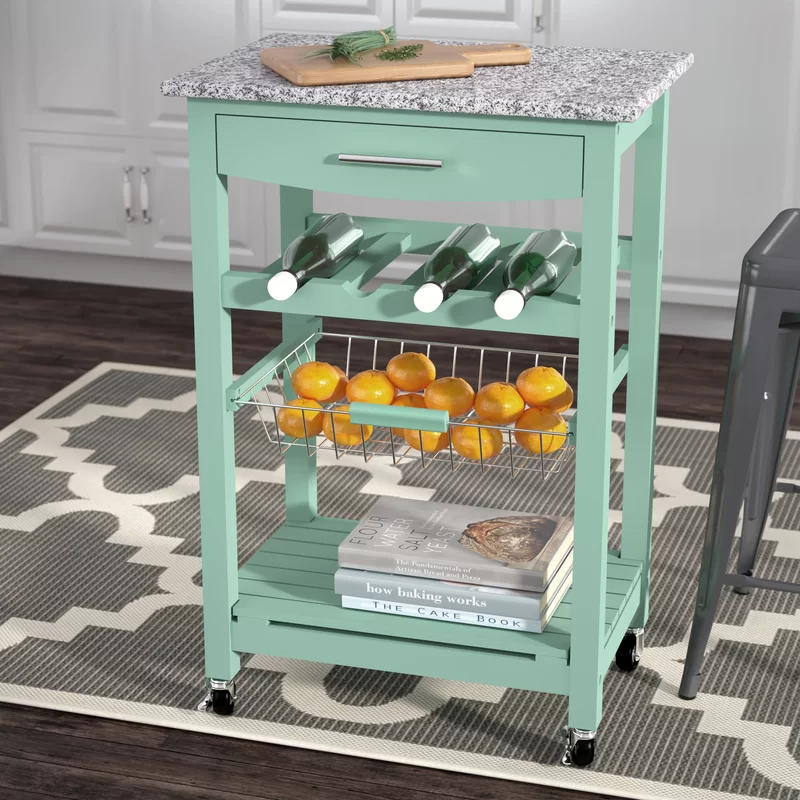 """<h2>52% Off Winston Porter Macy Kitchen Cart With Granite Top</h2><br><strong>2947 reviews and 4.7 out of 5 stars</strong><br>""""This is a very nice small cart. Fits nicely in a small space but big enough to hold enough wine bottles and wine glasses. Nice to have a drawer for accessories. Good for the price and easy to assemble."""" <em>– Wayfair Reviewer</em><br><br><em>Shop <strong><a href=""""https://www.wayfair.com/furniture/pdp/winston-porter-macy-kitchen-cart-with-granite-top-wnpr6115.html"""" rel=""""nofollow noopener"""" target=""""_blank"""" data-ylk=""""slk:Wayfair"""" class=""""link rapid-noclick-resp"""">Wayfair</a></strong></em><br><br><strong>Winston Porter</strong> Macy Kitchen Cart with Granite Top, $, available at <a href=""""https://go.skimresources.com/?id=30283X879131&url=https%3A%2F%2Fwww.wayfair.com%2Ffurniture%2Fpdp%2Fwinston-porter-macy-kitchen-cart-with-granite-top-wnpr6115.html"""" rel=""""nofollow noopener"""" target=""""_blank"""" data-ylk=""""slk:Wayfair"""" class=""""link rapid-noclick-resp"""">Wayfair</a>"""