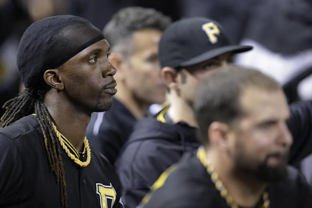 Pittsburgh Pirates' Andrew McCutchen, left, and teammates watch from the dugout during the eighth inning of of Game 5 of a National League baseball division series against the St. Louis Cardinals, Wednesday, Oct. 9, 2013, in St. Louis. The Cardinals won 6-1, and advanced to the NL championship series against the Los Angeles Dodgers. (AP Photo/Charlie Riedel)