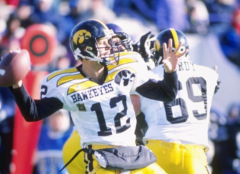 11 Nov 1995:  Quarterback Matt Sherman passes the ball as guard Matt Purdy of the Iowa Hawkeyes provides protection during a game against the Northwestern Wildcats at Dyche Stadium in Evanston, Illinois.  Northwestern won the game 31-20. Mandatory Credit: