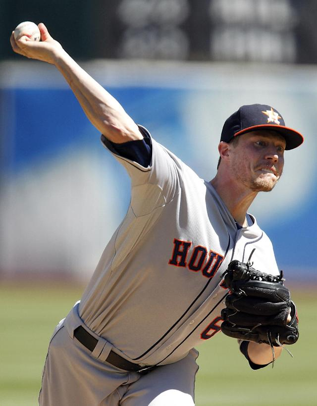Houston Astros starting pitcher Lucas Harrell (64) throws against the Oakland Athletics during the first inning of a baseball game, Sunday, Sept. 8, 2013, in Oakland, Calif. (AP Photo/Tony Avelar)