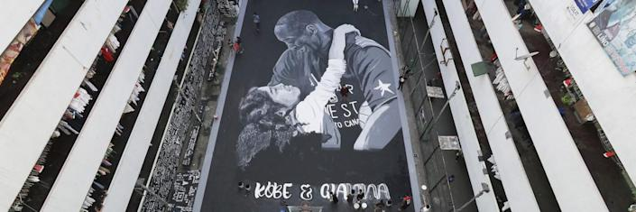 Artists put the finishing touches on a giant mural of Kobe and Gianna Bryant in Taguig, Philippines.