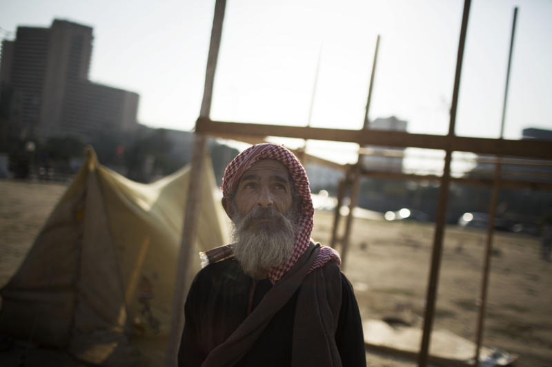 An Egyptian man stands in front of his tent in Tahrir Square where a few protesters have built their camp protesting against the release of Egypt's ousted President Hosni Mubarak in Cairo, Egypt, Saturday, Aug. 24, 2013. (AP Photo/Manu Brabo)