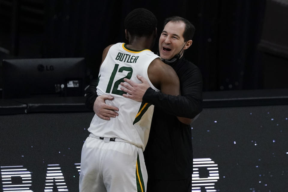 Baylor guard Jared Butler (12) gets a hug from head coach Scott Drew during the Bears' Final Four win over Houston. (AP Photo/Michael Conroy)