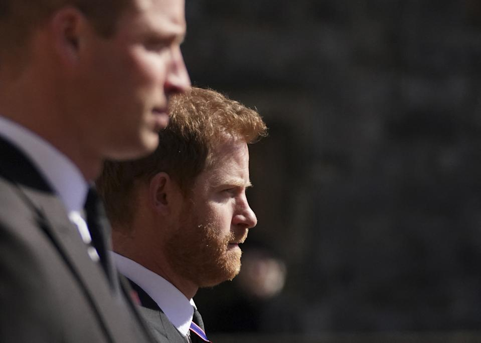 ALTERNATIVE CROP VERSION - Britain's Prince William, Duke of Cambridge, Peter Phillips and Britain's Prince Harry, Duke of Sussex walk during the funeral procession of Britain's Prince Philip, Duke of Edinburgh to St George's Chapel in Windsor Castle in Windsor, west of London, on April 17, 2021. - Philip, who was married to Queen Elizabeth II for 73 years, died on April 9 aged 99 just weeks after a month-long stay in hospital for treatment to a heart condition and an infection. - ALTERNATIVE CROP VERSION (Photo by Victoria Jones / POOL / AFP) / ALTERNATIVE CROP VERSION (Photo by VICTORIA JONES/POOL/AFP via Getty Images)