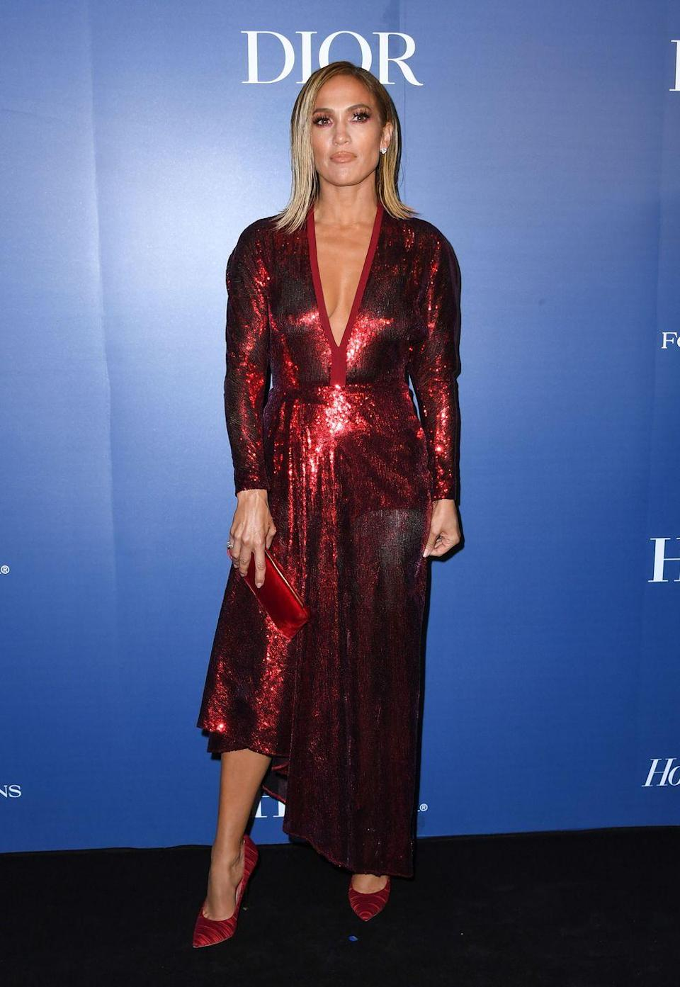 <p>Damn, does she look good in all red. That same day, at the Toronto International Film Festival, she wears a long-sleeve dress dripping in sequins and coordinating accessories. </p>