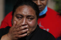 Gabriela Gomez cries after her sister Rosa Gomez was killed at the scene where police chief Omar García Harfuch was attacked by gunmen in Mexico City, Friday, June 26, 2020. Heavily armed gunmen attacked and wounded Mexico City's police chief in an operation that left several people dead. (AP Photo/Rebecca Blackwell)