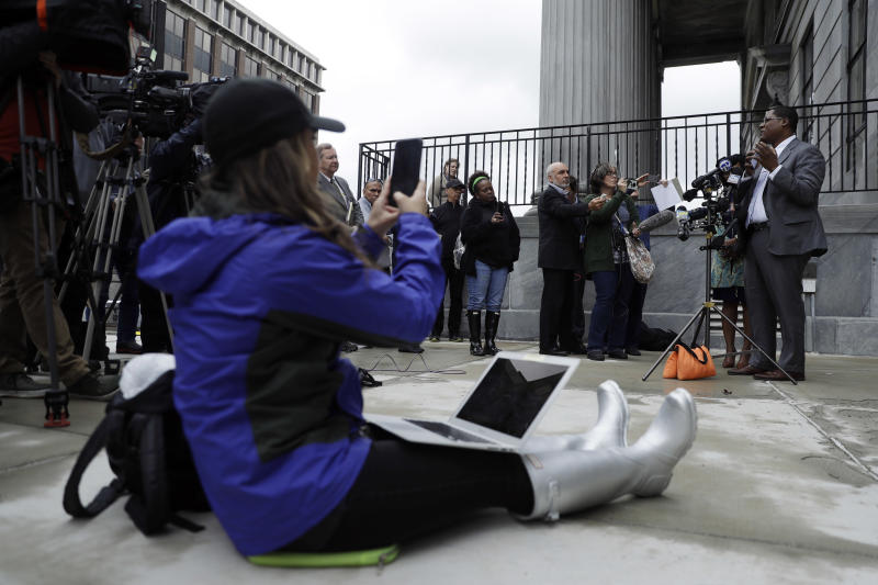 Bill Cosby's spokesman Andrew Wyatt, right, speaks to the media outside the Montgomery County Courthouse during a break in Cosby's sexual assault retrial, Monday, April 16, 2018, in Norristown, Pa. (AP Photo/Matt Slocum)