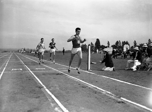 FILE - In a May 20, 1939 file photo, Louis Zamperini of he University of Southern California, breaks the tape and record with a time of 4:16.3 to win the mile run in the Pacific Coast Conference Track and Field meet the University of Washington Stadium in Seattle. Leo Girard, of Stanford, left, was second and Cole, of California, second from left, was third. Zamperini, a U.S. Olympic distance runner and World War II veteran who survived 47 days on a raft in the Pacific after his bomber crashed, then endured two years in Japanese prison camps, died Wednesday, July 2, 2014, according to Universal Pictures studio spokesman Michael Moses. He was 97. (AP Photo/Paul Wagner, File)